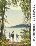 family on a day hike together... | Shutterstock . vector #375569182