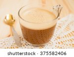 coffee in a cup on a table ... | Shutterstock . vector #375582406