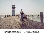 fit woman running with dogs | Shutterstock . vector #375605866