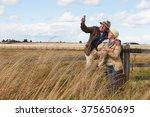 senior couple on walk taking... | Shutterstock . vector #375650695