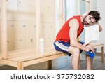 tired man wiping sweat with... | Shutterstock . vector #375732082