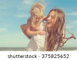 Small photo of Happy family. Young beautiful mother and her daughter having fun on the beach. Positive human emotions, feelings. Retro toned