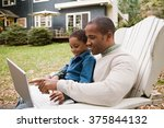 father and son using laptop in... | Shutterstock . vector #375844132