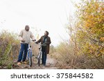 the couple pushing bicycles | Shutterstock . vector #375844582