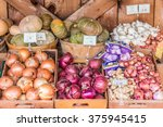 Small photo of Carmel Valley, California, USA - February 11, 2016: Organic onions, garlic and squash is on display at the outdoor farmer's market of Earthbound Farms.