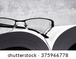 Black And White Eyeglasses On...