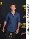 "Small photo of LOS ANGELES, CA - MARCH 19, 2014: Scott Eastwood at the premiere of ""Sabotage"" at Regal Cinemas L.A. Live."