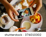 hands with the phone close up... | Shutterstock . vector #376010302