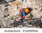 team of climbers on the rock. | Shutterstock . vector #376030966