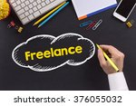 man working on desk and writing ... | Shutterstock . vector #376055032