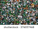 pebble with glass in sea coast | Shutterstock . vector #376057468