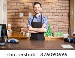 good looking young male cashier ... | Shutterstock . vector #376090696