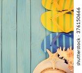 summer concept with flip flops    Shutterstock . vector #376150666
