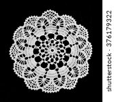 Lace Doily Isolated On Black...