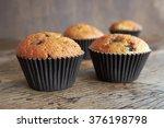 muffins on a dark wooden table.   Shutterstock . vector #376198798