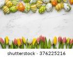 easter eggs and tulips on white ... | Shutterstock . vector #376225216