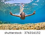 Small photo of Happy beautiful girl - young woman dive underwater with fun over coral reef in sea pool. Healthy active lifestyle, people water sport outdoor activity and swimming lessons on beach summer holidays.