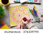 woman coloring an adult... | Shutterstock . vector #376339795