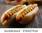 hot dogs on wooden background...   Shutterstock . vector #376427416