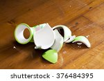 green broken vase on wooden... | Shutterstock . vector #376484395