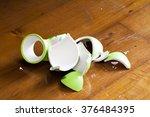 green broken vase on wooden...   Shutterstock . vector #376484395