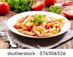 plate of pasta with tomato... | Shutterstock . vector #376506526