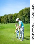 father and son playing golf | Shutterstock . vector #376510336