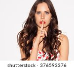 beautiful young woman pointing... | Shutterstock . vector #376593376