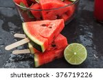 watermelon slices with lime on... | Shutterstock . vector #376719226