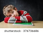 bored student laying his head... | Shutterstock . vector #376736686