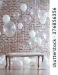 bench near balloons on brick... | Shutterstock . vector #376856356