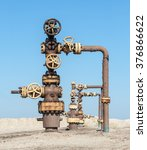 Small photo of Wellhead with valve armature. Oil, gas industry.