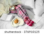 woman in pajamas reading a book ... | Shutterstock . vector #376910125