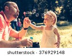 daddy and daughter blowing a... | Shutterstock . vector #376929148