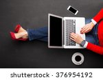 woman working on laptop  | Shutterstock . vector #376954192
