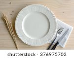 empty dish with knife and fork... | Shutterstock . vector #376975702