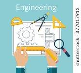 engineer working on blueprint.... | Shutterstock .eps vector #377017912