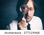 Businessman With Magnifying...