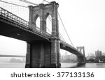 Stock photo view brooklyn bridge with foggy city in the background 377133136