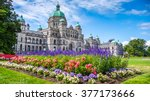 Stock photo beautiful view of historic parliament building in the citycenter of victoria with colorful flowers 377173666