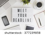 Stock photo meet your deadline words on office table with computer coffee notepad smartphone and digital 377239858