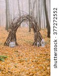 Stock photo creative cute decorated wedding arch and all exterior of holidays on the background autumn lake 377272552