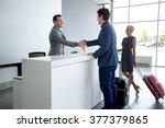 man and receptionist handshake... | Shutterstock . vector #377379865