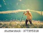 young woman hiking with... | Shutterstock . vector #377395318