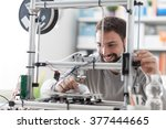 young designer engineer using a ... | Shutterstock . vector #377444665