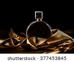perfume in gold tones | Shutterstock . vector #377453845