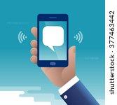 text messaging. hand holding... | Shutterstock .eps vector #377463442