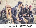 Small photo of Multicultural group of friends using cellphones - Students sitting in a row and typing on the smartphones, vintage filtered look