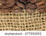 coffee beans closeup on natural ... | Shutterstock . vector #377592052