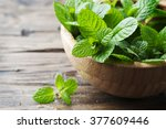 Green Fresh Mint Om The Wooden...